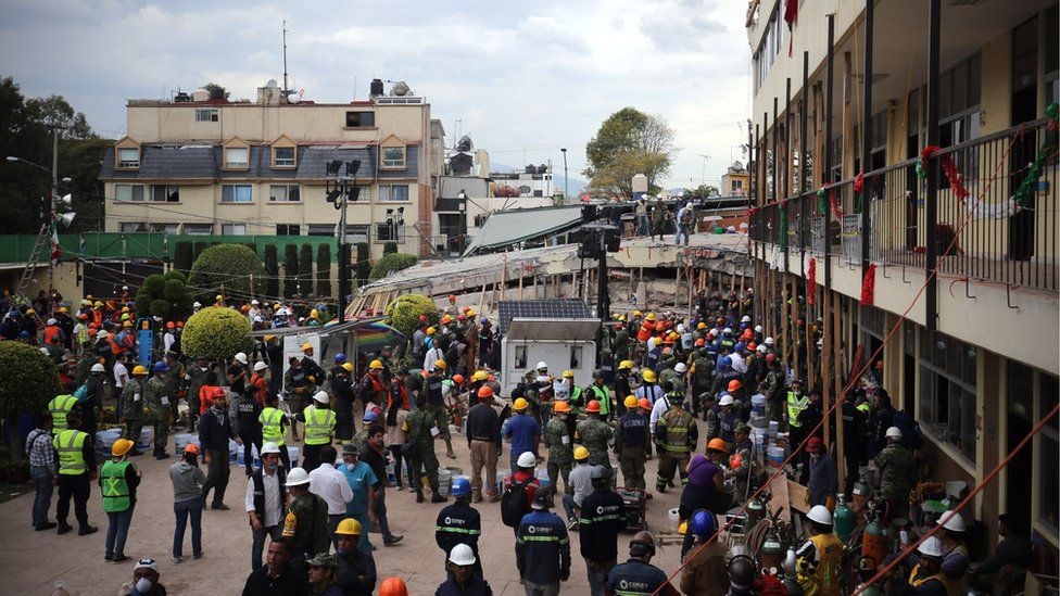 Rescue teams gather to help search for survivors at the Enrique Rébsamen primary school, Mexico City, 20 September 2017