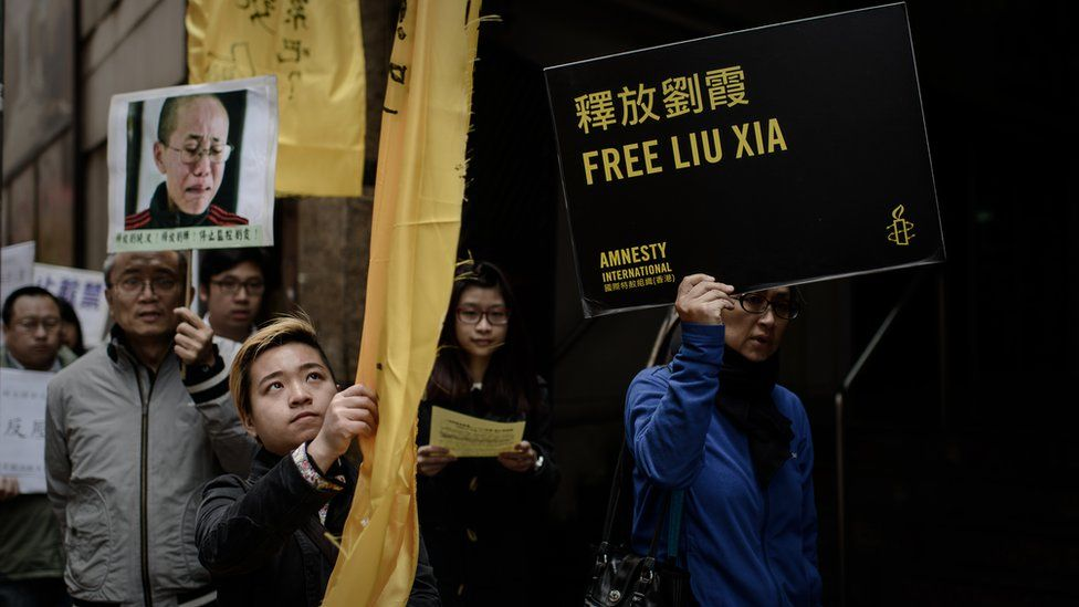 people with photograph of Liu Xia and Amnesty International placard saying Free Liu Xia