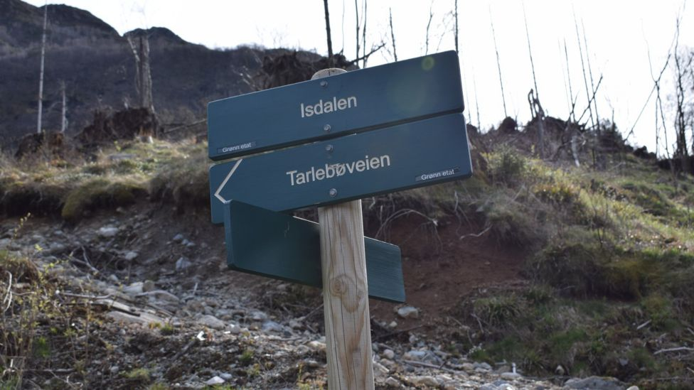 "A sign in the valley reads: ""Isdalen"""