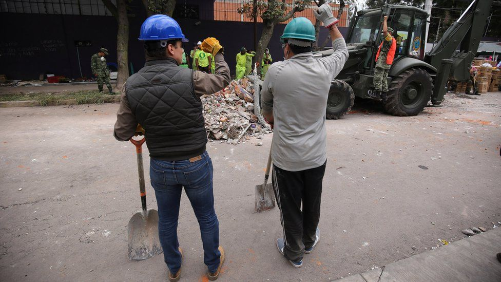 "Workers were regularly interrupted from clearing debris by shouts of ""¡silencio!"" as rescuers used sensitive instruments to try and find victims of the 7.1 magnitude earthquake, Mexico City, 20 September 2017"
