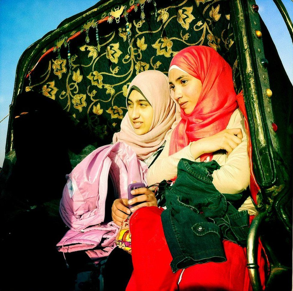 Two women in a horse carriage