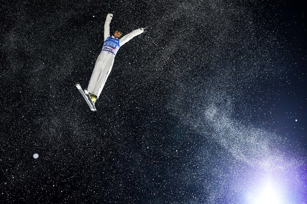 Qi Guangpu of China performs an aerial during the FIS Snowboarding and Freestyle Skiing World Championships.