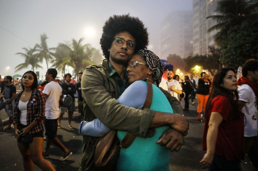 Orlando Caldeira embraces his mother Georgina at a demonstration and concert calling for direct presidential elections on May 28, 2017 in Rio de Janeiro, Brazil.