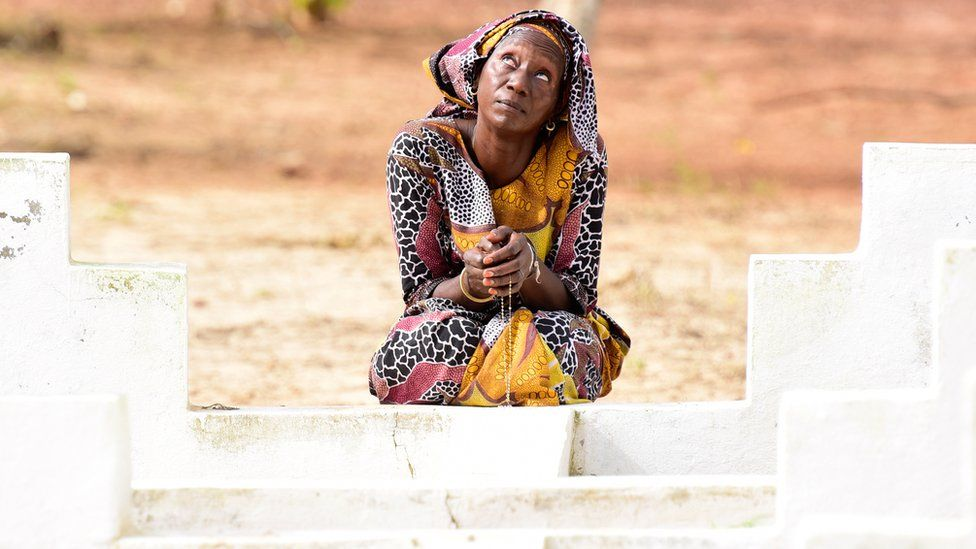 A Senegalese woman prays in front of the grave of a loved one as she marks the 15th anniversary of the sinking of the ship 'Le Joola' on September 26, 2017 in Dakar. Ceremonies marking the 15th anniversary of Senegal's Joola ferry tragedy, in which nearly 1,900 people died are taking place in Dakar