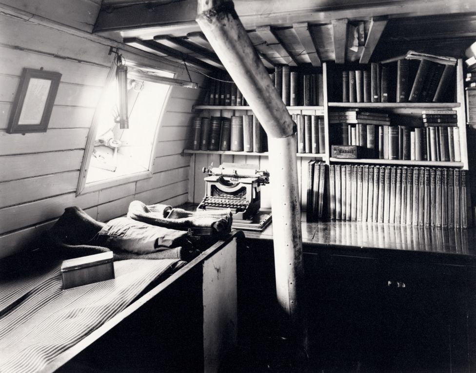 Black and white view of Shackleton's library on board the ship Endurance.
