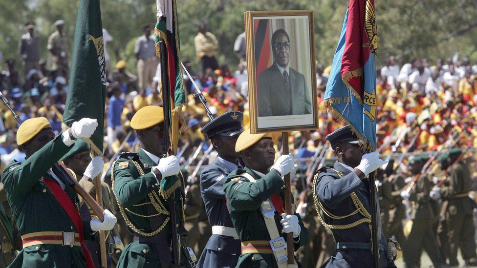 Zimbabwean troops holding a portrait of President Robert Mugabe parade in Harare, on April 18, 2008 during celebrations marking the country's 28th anniversary of independence