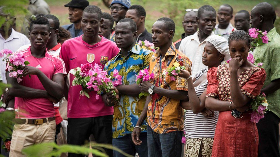 Friends, parents and relatives pay tribute to victims of the 18 June attack at the Campement Kangaba resort, close to the Malian capital Bamako.