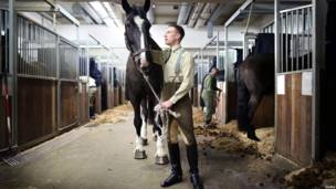 Solider and horse in stables