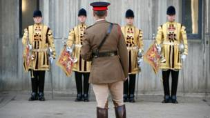 An officer inspects trumpeters