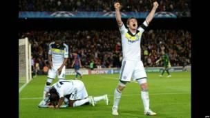 Chelsea football players celebrate winning a match
