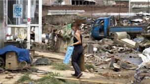Женщина, пострадавшая от наводнения в Пекине