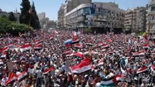 Manifestação pró-governo em Damasco/AFP