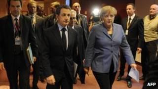 Sarkozy e Merkel. AFP