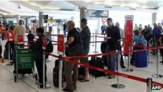 Passageiros da Qantas. Foto: AFP