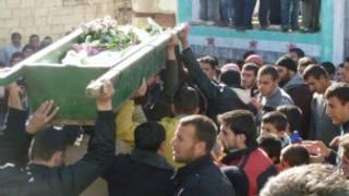 Masu zanga-zanga dauke da gawa a Syria