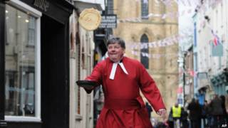 The Very Reverend Keith Jukes takes part in the annual Pancake Day Races along Kirkgate, Ripon.