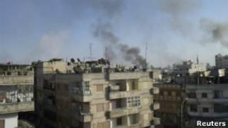Здания в огне в городе Хомс