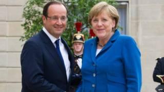 Меркель и Олланд после встречи в Париже
