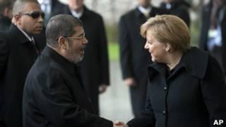 Mohamed Morsi y Angela Merkel