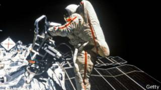 an astronaut repairing a malfunction in the Space