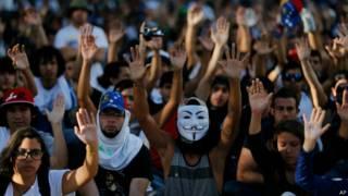 manifestantes em Caracas | AP