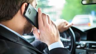 Разговор по мобильному за рулем