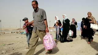 Refugiados iraquíes huyen de Mosul a Kurdistán