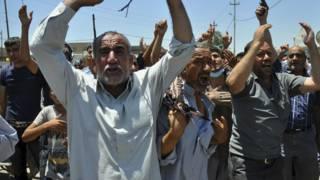 इराक़ शोक मनाते लोग