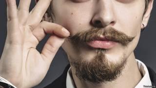 Бородатый и усатый молодой щеголь