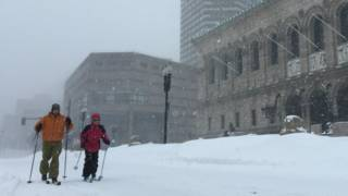 Skiers slide down Boston's Boylston Street
