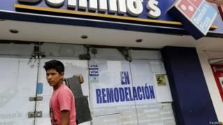 Fachada de loja da Domino's no Peru | Foto: Reuters