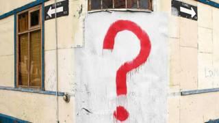 Знак вопроса на стене