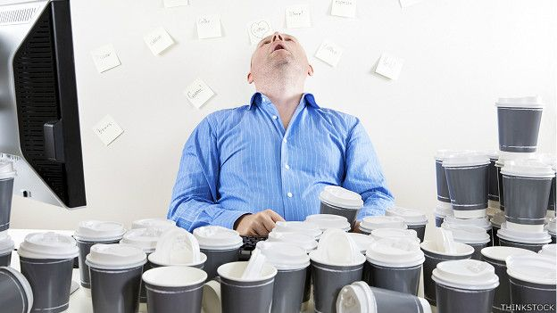 Executive who falls asleep in front of many glasses of coffee