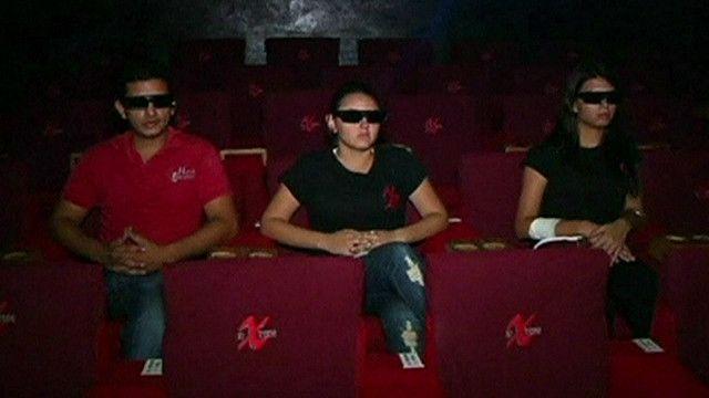 Espectadores en un cine 3D