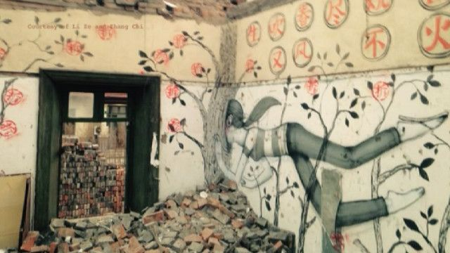 Рисунок на разрушенном здании
