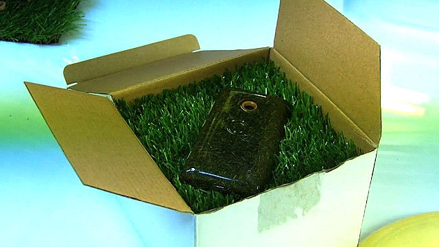 A mobile phone made out of grass