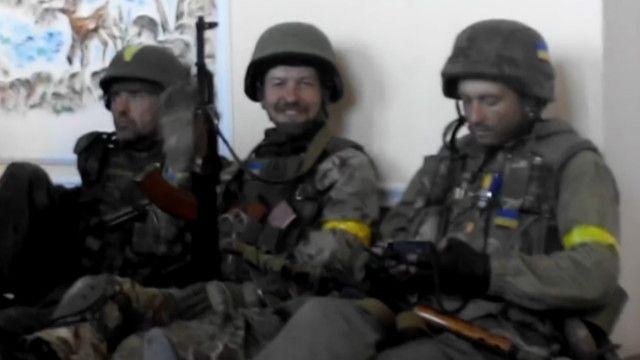 бійці у школі м. Іловайська